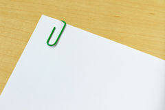 Paper with paper clip  on white Stock Photos