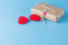 A paper parcel wrapped tied. A red heart on a gift box Royalty Free Stock Photos