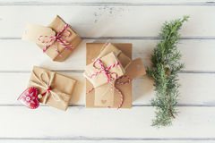 Paper parcels wrapped tied with tags. Some paper parcels wrapped tied with tags. A red heart and some christmas gift boxes wrapped with paper kraft and tied with Stock Image