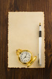 Paper parchment and ink pen on wood. En background Royalty Free Stock Image