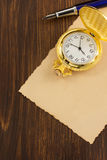 Paper parchment and ink pen on wood. En background Royalty Free Stock Photography