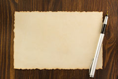 Paper parchment on wood. En background Royalty Free Stock Photography