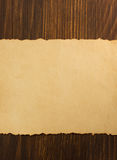 Paper parchment on wood. En background Stock Photography