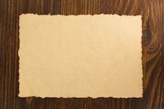 Paper parchment on wood. En background Stock Images
