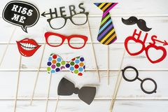 Paper Party Accessories. Red Paper Smiling Mouth,Glasses ,tie ,mustache and bow tie  .Party accessory Stock Images
