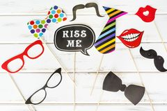 Paper Party Accessories. Red Paper Smiling Mouth,Glasses ,tie ,mustache,kiss me label and bow tie .Party accessory Stock Images