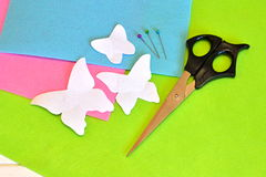 Paper patterns butterflies, scissors, pins, felt sheets. Sewing set Royalty Free Stock Image