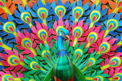 Paper Peacock. Peacock design made of different color paper and bamboo royalty free stock photography