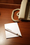 Paper and a pen Royalty Free Stock Photo