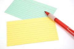 Paper and pen. Colorful lined paper with a pen spherical Stock Images
