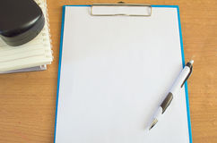 Paper pen and book on the desk office Royalty Free Stock Photo