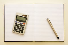 Paper with pen and calculator Royalty Free Stock Image