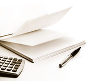 Paper, pen and calculator Royalty Free Stock Photo