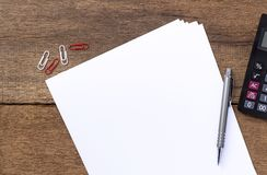 Paper with pen and calculator on desk. With copy space for text Stock Photos