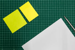 Paper and pen on cut sheets,office space background Royalty Free Stock Images