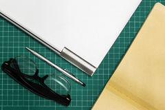 Paper and pen on cut sheets,office space background Royalty Free Stock Photography