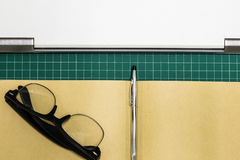 Paper and pen on cut sheets,office space background Royalty Free Stock Photos