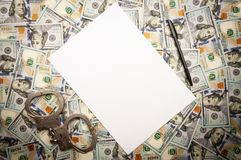 Paper pen and handcuffs on dollars background stock photography