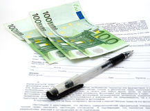 Paper, pen and money Royalty Free Stock Photo