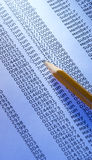 Paper and pencil. Special blue toned light photo f/x, focus point on writing part of pecil Royalty Free Stock Photography