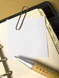 Paper with pencil. On a natural cardboard with filofax Stock Photography