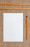 Paper and pencil on background Royalty Free Stock Photo