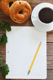 Paper and Pencil with Bagels and Coffee Royalty Free Stock Photos