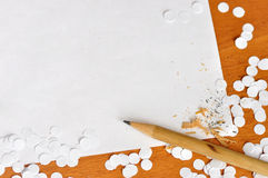 Paper and pencil. Royalty Free Stock Photos