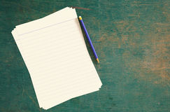 Paper and pencil. Royalty Free Stock Image