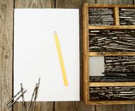 Paper with pencil and box, drills on wooden Royalty Free Stock Photography