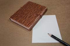 Paper. And pencil brown background Stock Image