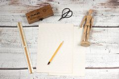 Paper and pencil with school supplies Royalty Free Stock Photos