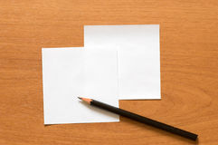Paper and pencil. Stock Images