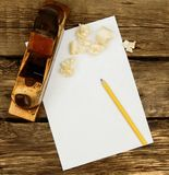 Paper with pencil and the vintage working tool on Stock Images