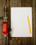 Paper with pencil and the vintage working tool on Stock Photo