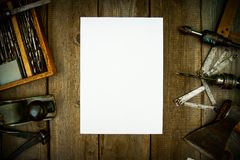 Paper with pencil and the vintage working tools on Stock Photo