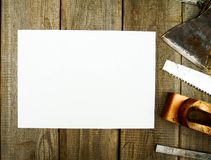 Paper with pencil and the vintage working tools on Royalty Free Stock Photos