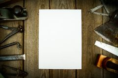 Paper with pencil and the vintage working tools on Stock Image