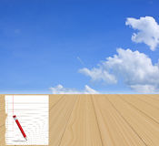 Paper and pencil on wood floor with  blue sky Royalty Free Stock Photography