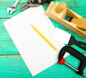 Paper with pencil and the working tool on wooden Royalty Free Stock Photos