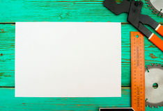 Paper with pencil and the working tool on wooden Stock Photos