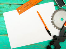 Paper with pencil and the working tool on wooden Stock Photography