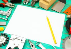 Paper with pencil and the working tool on wooden Stock Image