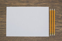 Paper and pencils on the wooden table. Close-up Stock Photography