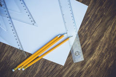 Paper and pencils on the wooden table. Close-up Royalty Free Stock Photos