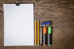 Paper and pencils on the wooden table. Close-up Stock Photo