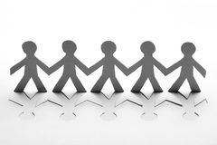 Paper people. In teamworking concept Royalty Free Stock Image
