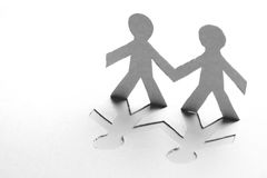 Paper people. Hand in hand Stock Photography