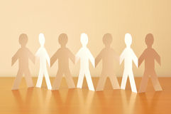 Paper-people. Team work. Paper-people holding hand Royalty Free Stock Photos