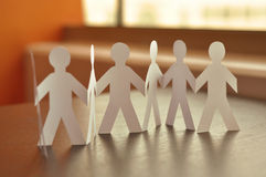 Paper-people. Team work. Paper-people holding hand Royalty Free Stock Images